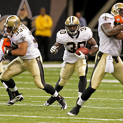 2009 August 14: New Orleans Saints running back Lynell Hamilton (30) runs through a hole during 17-7 win by the New Orleans Saints over the Cincinnati Bengals in their preseason opener at the Louisiana Superdome in New Orleans, Louisiana.