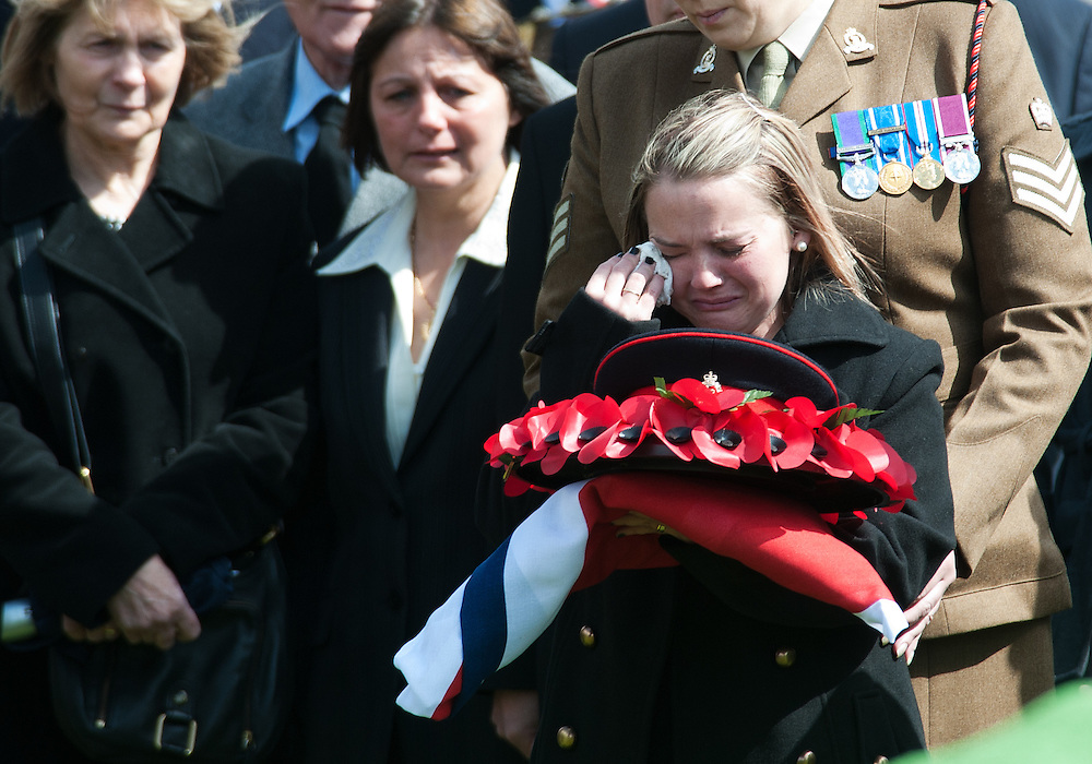 Widow Sophie Foley cries at the grave of her deceased husband  Lance Corporal Michael Foley in Didcot Cemetery in Oxfordshire on April 19th 2012..The Funeral of Lance Corporal Michael Foley. Lance Corporal Michael Foley, of the Adjutant General's Corps (Staff and Personnel Support) was one of two servicemen shot dead by an Afghan soldier on March 26.2012.Photo Ki Price.