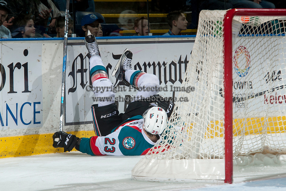 KELOWNA, CANADA - MARCH 7:  Reid Gardiner #23 of the Kelowna Rockets slides into the boards behind the net during second period against the Victoria Royals on March 7, 2017 at Prospera Place in Kelowna, British Columbia, Canada.  (Photo by Marissa Baecker/Shoot the Breeze)  *** Local Caption ***