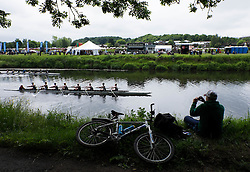 © Licensed to London News Pictures.13/06/15<br /> Durham, England<br /> <br /> A man takes a picture as he watches the racing during the 182nd Durham Regatta rowing event held on the River Wear. The origins of the regatta date back  to commemorations marking victory at the Battle of Waterloo in 1815. This is the second oldest event of this type in the country and attracts over 2000 competitors from across the country.<br /> <br /> Photo credit : Ian Forsyth/LNP