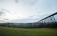 Salisbury Mills, New York -  Clouds and mist after a rain storm by the Moodna Viaduct railroad trestle on July 21, 2010.