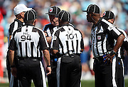 NFL officials huddle during the Carolina Panthers 2015 NFL week 2 regular season football game against the Houston Texans on Sunday, Sept. 20, 2015 in Charlotte, N.C. The Panthers won the game 24-17. (©Paul Anthony Spinelli)