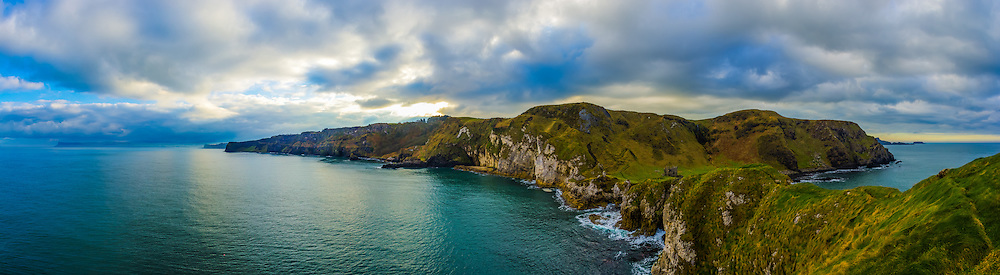This is a shot I got in November 2014 on my trip up to the North Coast with my friend and her visitors up at Kinbane Castle. This one is made up of 10 photos at 18mm in portrait orientation, offering a 180 degree view from the tip of Kinbane Head. Off to the far left you can see Fair Head and mist forming over Ballycastle Bay, sweeping along the coastline towards the ruins of Kinbane Castle in the middle foreground and onwards towards Carrick-A-Rede Rope Bridge and Sheep Island in the far distance off to the right.