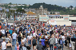 © Licensed to London News Pictures.  03/06/2017; Torbay, Devon, UK. Torbay Airshow 2017. Crowds at the 2017 Torbay Airshow. The 2017 Torbay Airshow returns this weekend on Saturday 3 and Sunday 4 June with an action packed programme of world class air displays. The world's premier aerobatic team The Red Arrows will be debuting a new routine in the first display of their season, featuring their trademark combination of close formations and precision flying. The full display programme for the weekend begins on the Saturday between 2-3pm with The Tigers Freefall Parachute Display Team, Team Raven Aerobatic Display Team, the Percival Piston Provost and the Strikemaster. From 3-4pm will be the highly anticipated display by the Red Arrows, former British Female Aerobatic Champion Lauren Richardson in her Pitts Special S1-S and world aerobatic competitor Gerald Cooper in his Xtreme XA41. Finishing off the action packed afternoon from 4-5pm will see displays from the AutoGyro, the Battle of Britain Memorial Flight aircraft, the PBY5A Catalina seaplane, The Blades and the Royal Air Force's Typhoon FGR4. Sunday afternoon will see each of the aircraft take to the skies again before the weekend closes with a final display from the RAF Chinook team. The two day show, which had its inaugural event last year, takes place on Paignton Green with the Bay providing a stunning natural amphitheatre for viewing the air displays and the perfect location for a large coastal airshow event. To stay up to date with the latest Torbay Airshow news and updates follow @torbayairshow on Facebook, Twitter and Instagram or visit www.torbayairshow.com. Picture credit : Simon Chapman/LNP