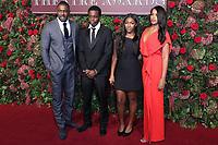 Idris Elba, Isan Elba, Sabrina Dhowre, 64th Evening Standard Theatre Awards, Theatre Royal Drury Lane, London UK, 18 November 2018, Photo by Richard Goldschmidt
