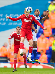 BIRMINGHAM, ENGLAND - Sunday, April 4, 2010: Liverpool's Lucas Leiva and Birmingham City's Cameron Jerome during the Premiership match at St Andrews. (Photo by David Rawcliffe/Propaganda)