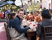 Celebrity Chef Curtis Stone, left, teams up with Ocean Spray to host a Thanksgiving dinner at their Big Apple Bog in celebration of the cooperative's 85th anniversary, Tuesday, Nov. 3, 2015 at Rockefeller Center in New York.   Find the perfect Thanksgiving plate and holiday inspiration at www.OceanSpray.com/PlanIt.  (Photo by Diane Bondareff/AP Images for Ocean Spray)