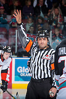 KELOWNA, CANADA - DECEMBER 4: Referee Kevin Webinger calls to the bench from the centre ice between the Kelowna Rockets and the Medicine Hat Tigers on December 4, 2015 at Prospera Place in Kelowna, British Columbia, Canada.  (Photo by Marissa Baecker/Shoot the Breeze)  *** Local Caption *** Kevin Webinger; referee; official;