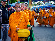 13 APRIL 2018 - BANGKOK, THAILAND:  People give alms to Buddhist monks to make merit during a religious observance of Songkran in Lumpini Park in Bangkok. Songkran is the traditional Thai New Year celebration best known for water fights.     PHOTO BY JACK KURTZ