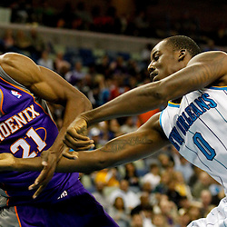 December 30, 2011; New Orleans, LA, USA; New Orleans Hornets small forward Al-Farouq Aminu (0) and Phoenix Suns power forward Hakim Warrick (21) fight over possession on the ball during the second quarter of a game at the New Orleans Arena.   Mandatory Credit: Derick E. Hingle-US PRESSWIRE
