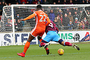 Shrewsbury Town defender Aristote Nsiala (22) brings down Scunthorpe United forward Ivan Toney (9)  during the EFL Sky Bet League 1 match between Scunthorpe United and Shrewsbury Town at Glanford Park, Scunthorpe, England on 17 March 2018. Picture by Mick Atkins.