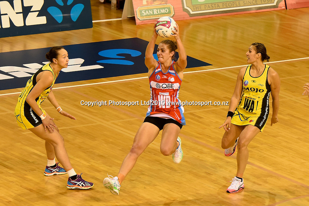Swifts' Abbey McCulloch (C takes a pass with Pulse's Elias Shadrock (L) and Pulse's Liana Leota in defense during the ANZ Championship - Pulse v Swifts netball match at the TSB Arena in Wellington on Saturday the 25th of April 2015. Photo by Marty Melville / www.Photosport.co.nz