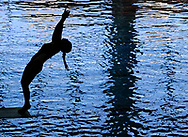 A competitor from Santa Barbara College performing a backwards dive during preliminaries at East Los Angeles College for the State Championships Monterey Park, Calif. on May 4, 2017.<br /> <br /> Photo by Randi Love / Sports Shooter Academy