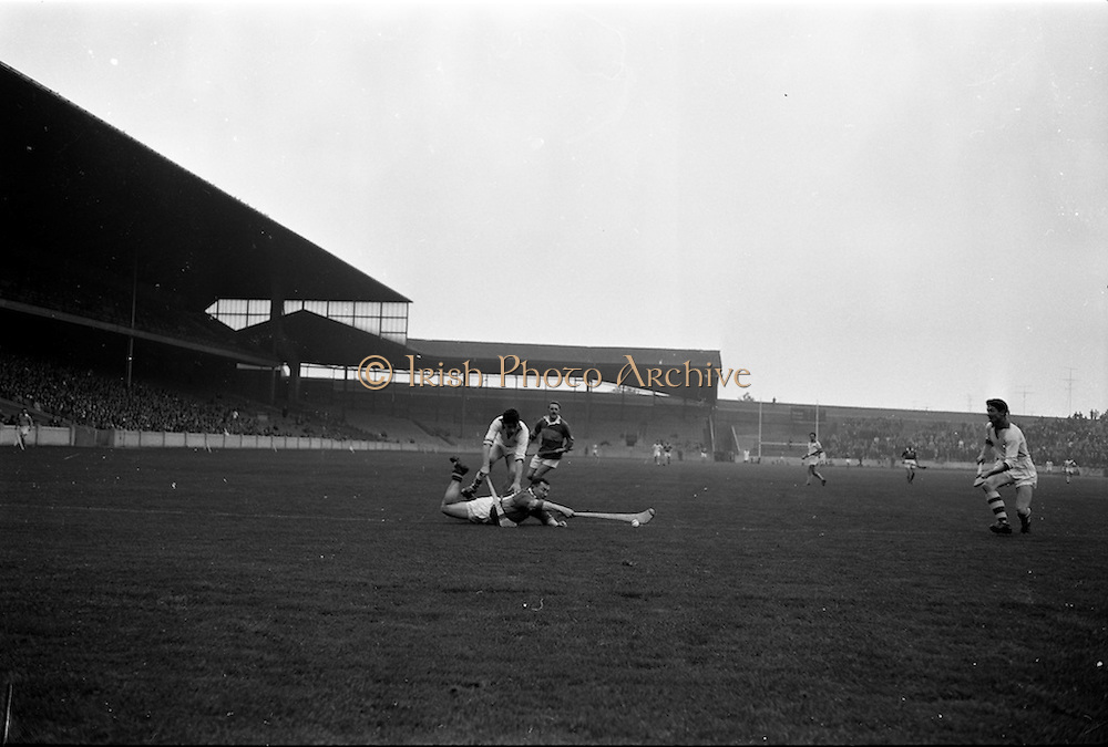 21/10/1962<br /> 10/21/1962<br /> 21 October 1962<br /> Oireachtas Final: Tipperary v Waterford at Croke Park, Dublin.<br /> Tipperary's J. McKenna dives full length to strike the ball under pressure from Waterford's J. Byrne.