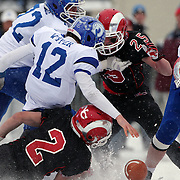 Darien quarterback Silas Wyper, (twelve), loses possession of the ball as he is sacked by Cole Harris, New Canaan, during the New Canaan Rams Vs Darien Blue Wave, CIAC Football Championship Class L Final at Boyle Stadium, Stamford. The New Canaan Rams won the match in snowy conditions 44-12. Stamford,  Connecticut, USA. 14th December 2013. Photo Tim Clayton