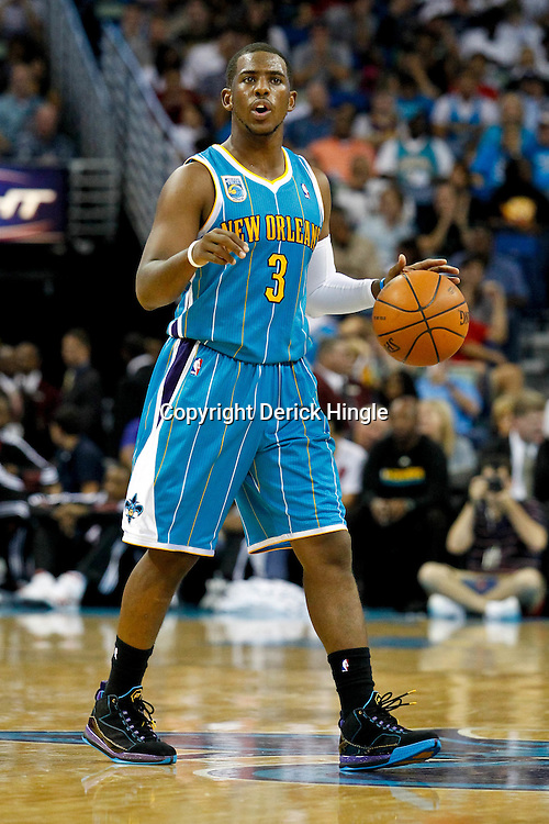 October 13, 2010; New Orleans, LA, USA; New Orleans Hornets point guard Chris Paul (3) controls the ball during the second quarter of a preseason game against the Miami Heat at the New Orleans Arena. Mandatory Credit: Derick E. Hingle
