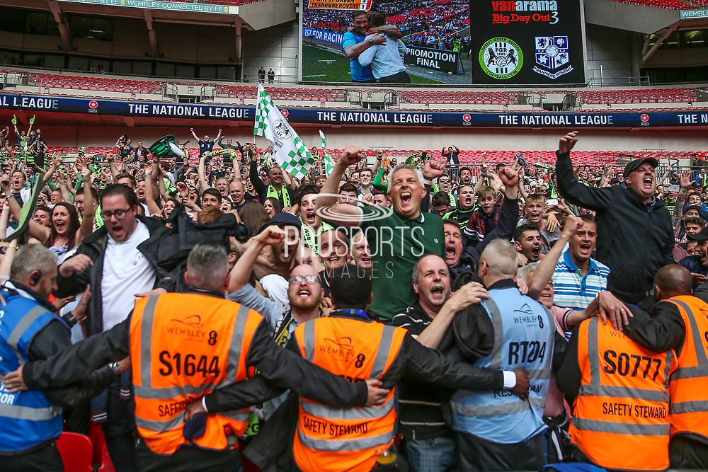 The final whistles goes and the Forest Green Rovers fans celebrate during the Vanarama National League Play Off Final match between Tranmere Rovers and Forest Green Rovers at Wembley Stadium, London, England on 14 May 2017. Photo by Shane Healey.