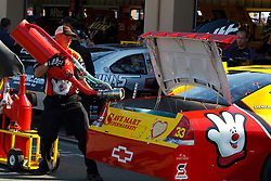 June 25, 2011; Sonoma, CA, USA;  A crew member fuels the car of Sprint Cup Series driver Clint Bowyer (not pictured) outside of the garage before practice for the Toyota/Save Mart 350 at Infineon Raceway.