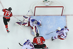 May 21, 2012; Newark, NJ, USA; New York Rangers goalie Henrik Lundqvist (30) makes a save on New Jersey Devils left wing Ilya Kovalchuk (17) during the first period in game four of the 2012 Eastern Conference Finals at the Prudential Center.  The Devils defeated the Rangers 4-1.