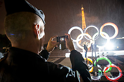 &copy; Licensed to London News Pictures13/09/2017 Paris, France.  <br /> <br /> 13 September 2017, Trocadero Paris (France): A gendarme indulges a couple with VIP passes to be amongst the first photographed dancing in front of the newly unveiled Olympic Rings. The IOC (International Olympic Committee) formally announce the host of the 2024 Summer Games awarding Paris the distinction.<br /> Photo credit: Guilhem Baker/LNP