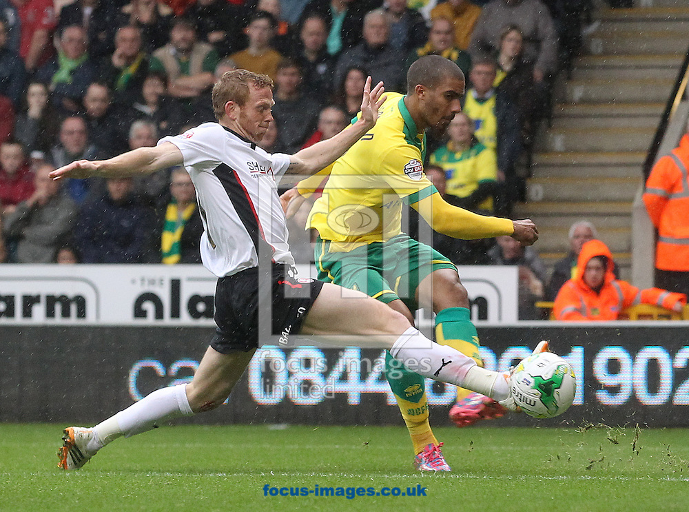 Lewis Grabban of Norwich has a shot on goal during the Sky Bet Championship match at Carrow Road, Norwich<br /> Picture by Paul Chesterton/Focus Images Ltd +44 7904 640267<br /> 04/10/2014