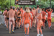Naked runners take part in the ZSL London Zoo Streak for Tigers. They are raising money for tigers whose group name is, apparently, a streak.