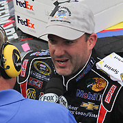 Tony Stewart interviews with Fox sports after winning the NASCAR SPRINT CUP SERIES FEDEX 400 BENEFITING AUTISM SPEAKS auto race at Dover International Speedway in Dover, DE., Sunday,  June 02, 2013.