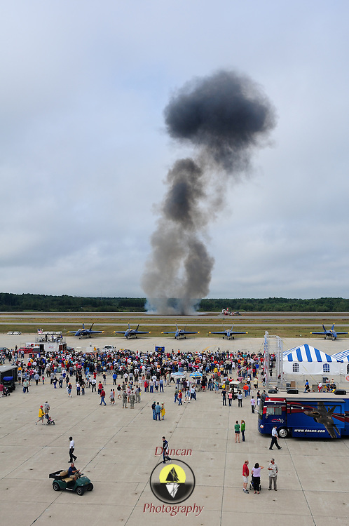 September 6, 2008 -- NAS BRUNSWICK, Maine. The smoke cloud from a pyrotechnics display rises above the flight line at NAS Brunswick on Saturday as part of The Great State of Maine Airshow. Due to increasingly bad weather on Saturday, visitation reached only 50,000 -- and The Blue Angels cancelled their Saturday demonstration. The airshow visited Naval Air Station Brunswick for the last time this weekend, bringing The U.S. Navy Blue Angels, The U.S. Army Golden Knights and a wide variety of static displays and interactive exhibits. The show drew over 150,000 people over three days with no mishaps among the performers and no emergencies among the attendees. .Because NAS Brunswick is scheduled to be closed in 2011 by the Base Realignment Commission, there will not be another Navy-sponsored airshow at this location. Yet, the Local Redevelopment Authority, responsible for managing the property after the departure of the Navy,  has included an airshow on a list of possible future uses for the property.  U.S. Navy Photo by Mass Communication Specialist 1st Class Roger S. Duncan (RELEASED)