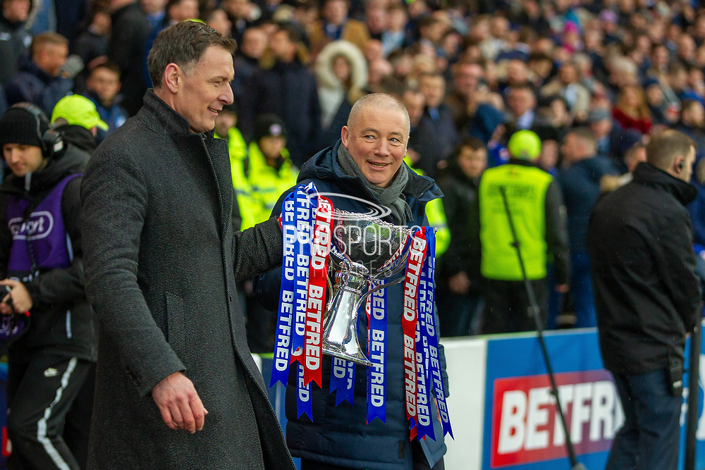 Rangers Legend Ally McCoist gives Celtic Legend Chris Sutton the eyes as they carry out the Betfred Scottish League Cup ahead of the Betfred Scottish League Cup Final match between Rangers and Celtic at Hampden Park, Glasgow, United Kingdom on 8 December 2019.