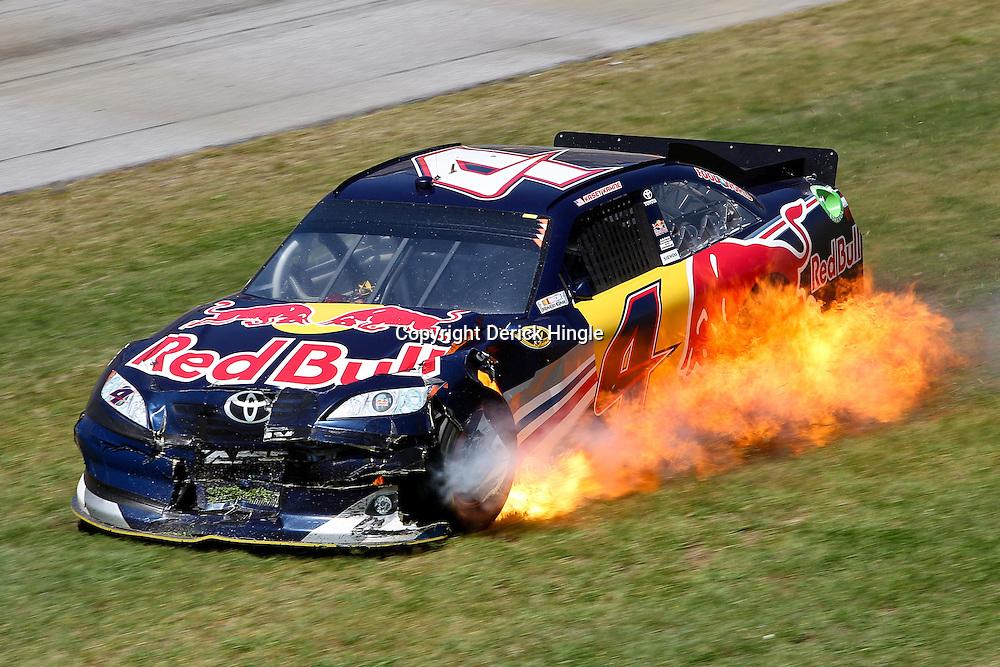 April 17, 2011; Talladega, AL, USA; NASCAR Sprint Cup Series driver Kasey Kahne (4) car catches fire after following a wreck during the Aarons 499 at Talladega Superspeedway.   Mandatory Credit: Derick E. Hingle