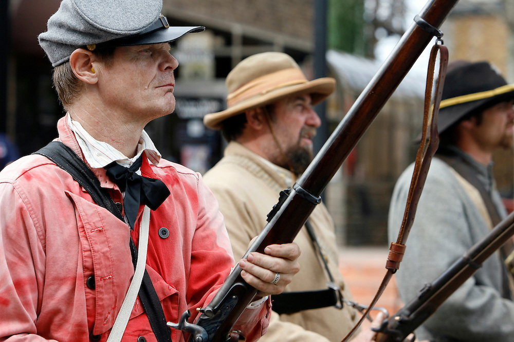 Curt Waldrip, left, stands at the ready during a Battle of Galveston reenactment on the Strand in Galveston, Texas on Sunday, Jan. 15, 2012. The Battle of Galveston Reenactment was part of a series of events marking the 149th anniversary of the Civil War Battle of Galveston, in which Confederate troops regained control of Galveston Harbor.