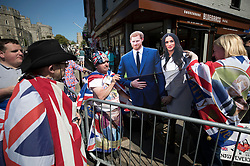 © Licensed to London News Pictures. 15/05/2018. Windsor, UK. Royal fans, who are the first to camp out on the procession route in Windsor High Street, display a life size cardboard cut out of the royal couple - ahead of the marriage of Prince Harry and Meghan Markle on Saturday. Photo credit: Peter Macdiarmid/LNP