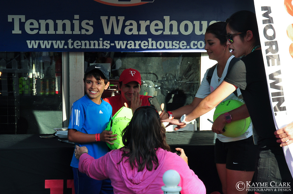 Roger Federer signing autographs for Tennis Warehouse at the BNP Paribas Open in Indian Wells, California.