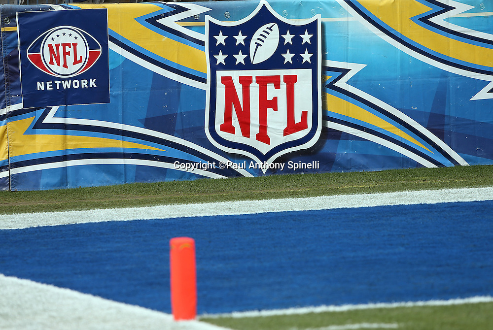 The NFL shield and NFL Network banners hang from the sideline wall adorned with the San Diego Chargers logo before the NFL week 17 football game against the Oakland Raiders on Sunday, Dec. 30, 2012 in San Diego. The Chargers won the game 24-21. ©Paul Anthony Spinelli