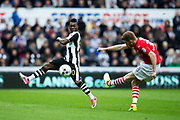 Newcastle United midfielder Christian Atsu (#30) attempts to block a clearance from Barnsley defender Callum Elder (#38) during the EFL Sky Bet Championship match between Newcastle United and Barnsley at St. James's Park, Newcastle, England on 7 May 2017. Photo by Craig Doyle.