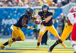 Sep 10, 2016; Morgantown, WV, USA; West Virginia Mountaineers quarterback Skyler Howard (3) hands the ball off to West Virginia Mountaineers running back Rushel Shell (7) during the second quarter against the Youngstown State Penguins at Milan Puskar Stadium. Mandatory Credit: Ben Queen-USA TODAY Sports