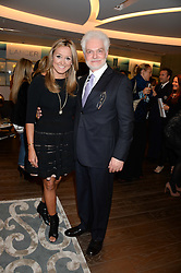 DR HAROLD LANCER and MARIGAY McKEE at a reception to launch the range of Dr Lancer beauty products held at The Penthouse, Harrods, Knightsbridge, London on 16th September 2013.