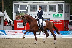 Jorst Charlotte (USA) - Vitalis <br /> FEI World Breeding Dressage Championships for Young Horses - Verden 2013<br /> © Dirk Caremans