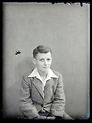 vintage formal studio portrait of young male person, circa 1930s