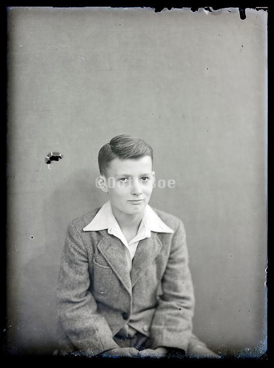 vintage formal studio portrait of young male person, circa 1930s