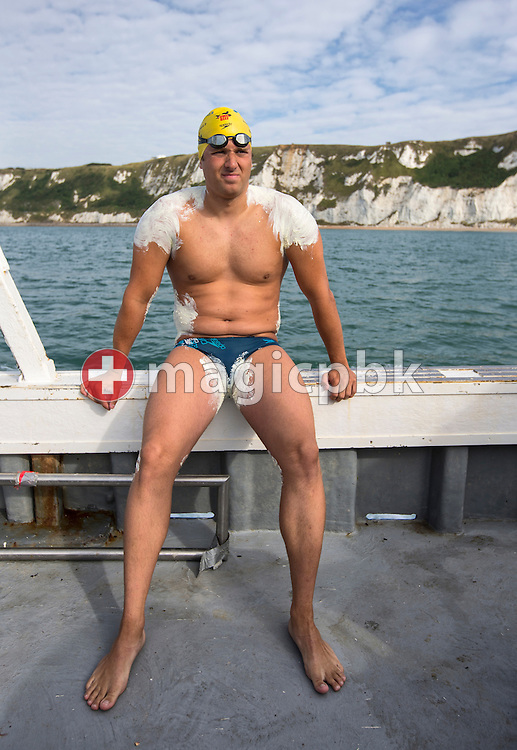 Swimmer Gino Deflorian of Switzerland is pictured after sensitive areas of his body have been covered with Lanolin (wool fat) during final preparation on the fishing boat Rowena before crossing the English Channel in 11 Hours 6 Minutes from Samphire Hoe (Great Britain) to Cap Gris Nez (France), in Samphire Hoe/Dover, Great Britain, Tuesday, Aug. 20, 2013. Gino Deflorian is the first Swiss male swimmer who successfully swims the English Channel and the third Swiss. (Photo by Patrick B. Kraemer / MAGICPBK)