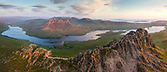 An aerial perspective overlooking Stac Pollaidh at sunset with loch lurgainn and Sgor Tuath beyond.  Assynt, Scotland.