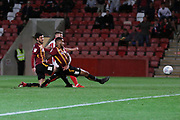 Gavin Reilly scores and runs off to celebrate  during the EFL Sky Bet League 2 match between Cheltenham Town and Bradford City at Jonny Rocks Stadium, Cheltenham, England on 17 September 2019.