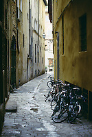 Many bicycles in a narrow street Florence Italy