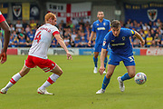 AFC Wimbledon midfielder Callum Reilly (33) battles for possession with Rotherham United midfielder Shaun MacDonald (4) during the EFL Sky Bet League 1 match between AFC Wimbledon and Rotherham United at the Cherry Red Records Stadium, Kingston, England on 3 August 2019.