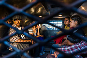 04 NOVEMBER 2005 - NACO, AZ: Undocumented immigrants from Mexico in the back of a US Border Patrol van being returned to Mexico through the voluntary return gate at the Port of Entry in Naco, AZ. PHOTO BY JACK KURTZ