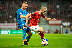 Jasmin Kurtič of Slovenia vs Konrad Laimer of Austria during the 2020 UEFA European Championships group G qualifying match between Austria and Slovenia at Wörthersee Stadion on June 7, 2019 in Klagenfurt, Austria. Photo by Vid Ponikvar / Sportida