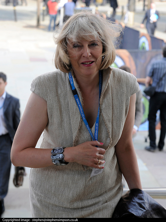 © Licensed to London News Pictures. 03/10/2011. MANCHESTER. UK. The Home Secretary Theresa May MP arrives windswept at The Conservative Party Conference at Manchester Central today, October 3, 2011. Photo credit:  Stephen Simpson/LNP