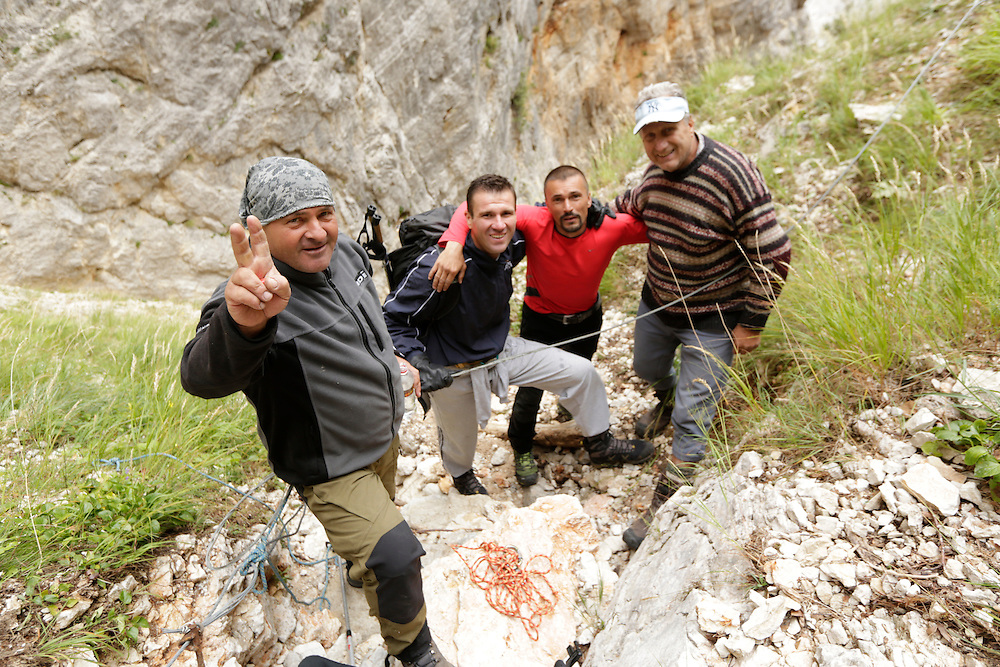 From l to r: Senad Djelmo Kulja, the stranded hiker Boris, Kenan Muftic and Braco Zahirovic, following the successful rescue at Veliki Kuk, Čvrsnica mountain, Bosnia and Herzegovina.  The uninjured hiker was found standing on a very small ledge in a narrow couloir, unable to move in any direction due to its perilous position.