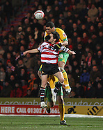 Doncaster - Friday January 30th 2009:Darel Russell of Norwich City & Brian Stock of Doncaster Rovers in action during the Coca Cola Championship Match at The Keepmoat Stadium Doncaster. (Pic by Steven Price/Focus Images)